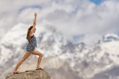 Woman doing yoga with Himayalayan mountain Royalty Free Stock Image