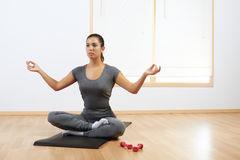 Woman doing yoga at home Royalty Free Stock Images