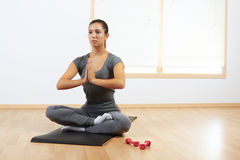 Woman doing yoga at home Royalty Free Stock Image
