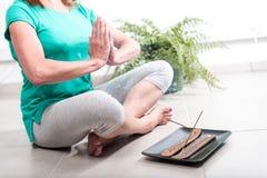 Woman doing yoga at home Royalty Free Stock Image