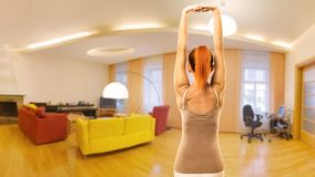 Woman doing yoga at home Stock Photography