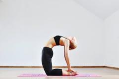 Woman doing yoga indoors Royalty Free Stock Photos
