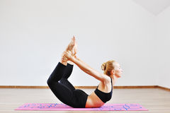 Woman doing yoga indoors Stock Images