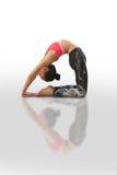 Woman doing yoga kapotasana. Beautiful woman doing yoga on a white background Stock Image