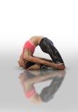 Woman doing yoga kapotasana. Beautiful woman doing yoga on a white background Stock Photography