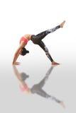 Woman doing yoga kapotasana. Beautiful woman doing yoga on a white background Royalty Free Stock Images