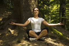 Woman doing  yoga in lotus position outdoors Royalty Free Stock Photos