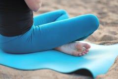 Woman doing yoga - meditating and relaxing in Padmasana Lotus Pose stock images