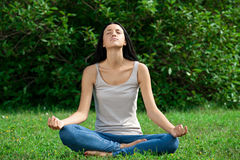 Woman doing yoga meditation Stock Photography