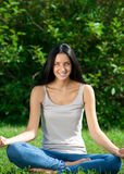 Woman doing yoga meditation Royalty Free Stock Images