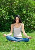 Woman doing yoga meditation Stock Images