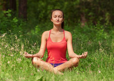 Woman doing yoga meditation Stock Photo