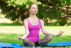 Woman doing yoga meditation Royalty Free Stock Photo