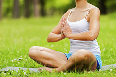 Woman doing yoga on the medow. Stock Photography