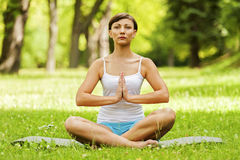 Woman doing yoga on the medow. Stock Photo