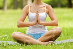 Woman doing yoga on the medow. Stock Images