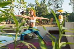 Woman doing yoga in the morning Stock Images