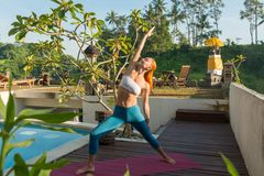 Woman doing yoga in the morning Royalty Free Stock Photography