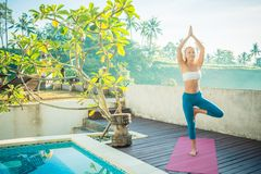 Woman doing yoga in the morning Royalty Free Stock Images