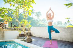 Woman doing yoga in the morning Stock Photo