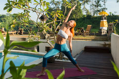 Woman doing yoga in the morning Stock Image