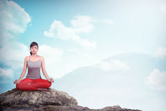 Woman Doing Yoga At The Mountain Royalty Free Stock Photos