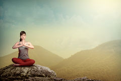 Woman Doing Yoga At The Mountain Stock Images