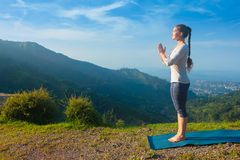 Woman doing yoga in mountains stock image