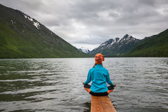 Woman is doing yoga at Multinskoe lake Stock Image