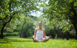 Woman doing yoga in natural environment Stock Photos