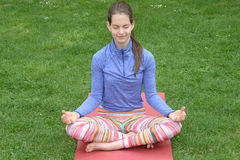 Woman doing yoga in nature Royalty Free Stock Photography