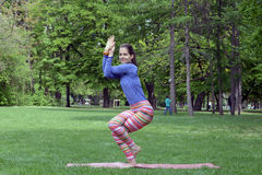 Woman doing yoga in nature Royalty Free Stock Image