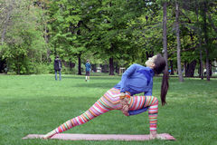 Woman doing yoga in nature Royalty Free Stock Photos