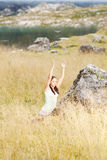 Woman doing yoga in nature. Young woman doing yoga exercises in high grass Stock Photo
