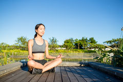 Woman doing yoga at outdoor Royalty Free Stock Photography