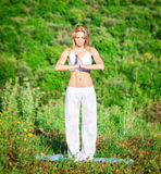 Woman doing yoga outdoors Royalty Free Stock Photo