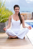 Woman doing yoga outdoors Royalty Free Stock Photography