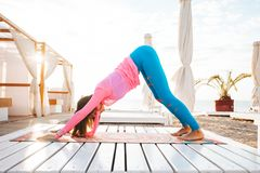 Woman doing yoga outdoors in the morning royalty free stock photos