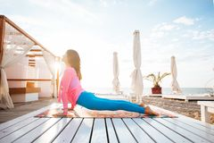 Woman doing yoga outdoors in the morning stock image