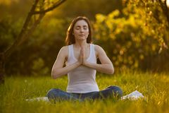 Woman doing yoga outdoors Stock Image