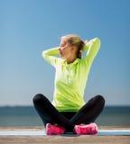 Woman doing yoga outdoors Stock Photography
