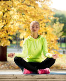 Woman doing yoga outdoors Royalty Free Stock Images