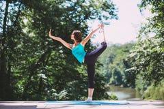 Woman doing yoga outdoors. Stock Photos