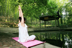 woman doing YOGA outside Stock Image