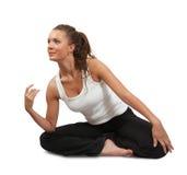 Woman doing yoga over white Stock Image