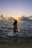 Woman doing yoga on a paddle board Stock Photo