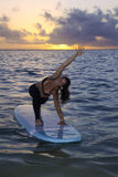 Woman doing yoga on a paddle board Royalty Free Stock Image