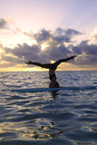 Woman doing yoga on a paddle board Stock Images