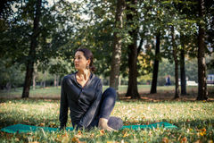 Woman doing yoga in park. Beautiful woman doing yoga in park Royalty Free Stock Photos