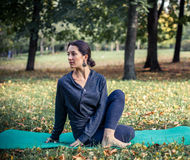 Woman doing yoga in park. Beautiful woman doing yoga in park Royalty Free Stock Photography